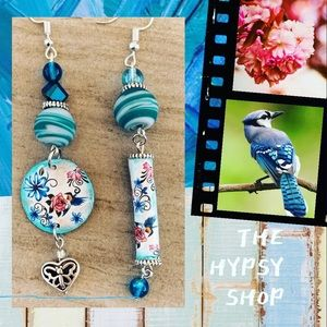 Up cycled earrings .